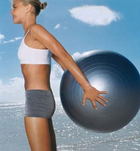 Rear lift. You will replace stability ball with one weight in each hand.